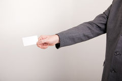 Businessman holding out a blank card Stock Images