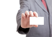 Businessman holding out a blank card Royalty Free Stock Image