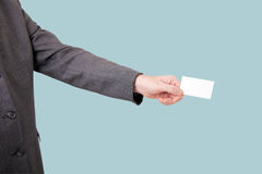 Businessman holding out a blank card Stock Photos