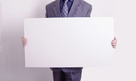 Businessman holding out a blank card Royalty Free Stock Photos