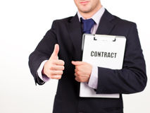 Businessman holding out a contract Royalty Free Stock Photo