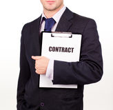 Businessman holding out a contract Royalty Free Stock Images