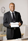 Businessman holding out contract Stock Photos