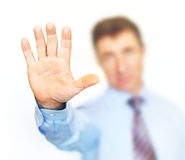 Businessman holding out his hand to show 'stop!' Royalty Free Stock Photo