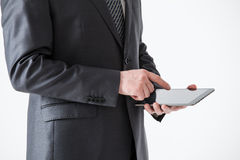 Businessman holding a pad Stock Photography