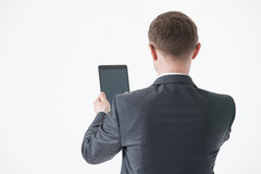 Businessman holding a pad Stock Image