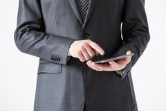 Businessman holding a pad Royalty Free Stock Photos