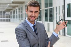 Businessman holding a pair of scissors Royalty Free Stock Image