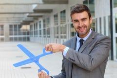 Businessman holding a pair of scissors Stock Photo