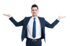 Businessman holding palms up as scale or balance Stock Photo