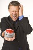 Businessman Holding A Panic Button Royalty Free Stock Photos