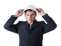 A businessman is holding a paper above his head Stock Photos