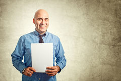 Businessman holding paper Stock Image