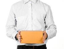 Businessman holding a paper box royalty free stock image