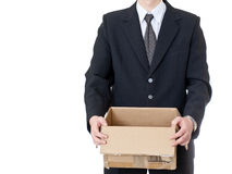 Businessman holding paper box on white background Stock Photography
