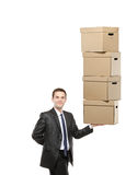 Businessman holding a paper boxes Stock Photos