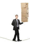 A businessman holding paper boxes Royalty Free Stock Image