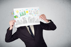 Businessman holding a paper with charts and cityscape in front o Stock Photo