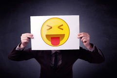 Businessman holding paper with emoticon Stock Photo