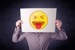 Businessman holding paper with emoticon Royalty Free Stock Image