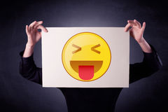 Businessman holding paper with emoticon Stock Photos