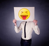 Businessman holding paper with emoticon Royalty Free Stock Photography
