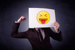 Businessman holding paper with emoticon Royalty Free Stock Photo