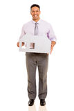 Businessman holding paper house Royalty Free Stock Image