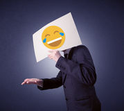 Businessman holding paper with laughing emoticon Royalty Free Stock Photo