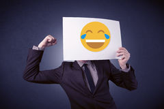 Businessman holding paper with laughing emoticon Stock Photography