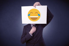 Businessman holding paper with laughing emoticon Royalty Free Stock Images