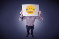 Businessman holding paper with laughing emoticon Royalty Free Stock Photos