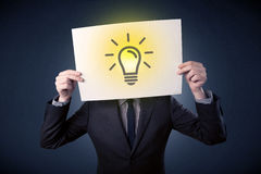 Businessman holding paper with lightbulb Stock Images