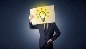 Businessman holding paper with lightbulb Royalty Free Stock Image