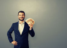Businessman holding paper money Royalty Free Stock Photos