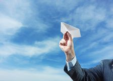 Businessman holding paper plane in his hand Royalty Free Stock Photo