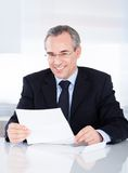 Businessman holding paper Royalty Free Stock Images