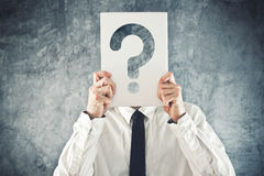 Businessman holding paper with printed question mark Royalty Free Stock Images