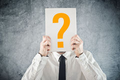 Businessman holding paper with printed question mark Royalty Free Stock Photo