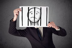 Businessman holding a paper with a prisoner behind the bars on i Royalty Free Stock Images