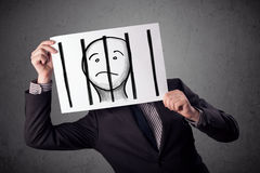 Businessman holding a paper with a prisoner behind the bars on i Royalty Free Stock Photography