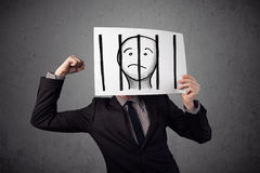 Businessman holding a paper with a prisoner behind the bars on i Stock Image