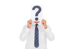Businessman holding a paper with a question mark over face Stock Images