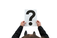 Businessman holding paper with question mark sign Royalty Free Stock Image