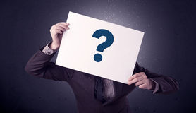 Businessman holding paper with question marks Royalty Free Stock Photos