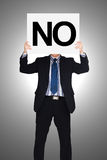 Businessman holding paper that say no Royalty Free Stock Images