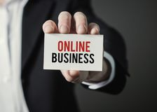 Businessman holding paper with text Online Business. Businessman holding card. Royalty Free Stock Photos