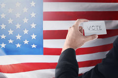 Businessman holding paper with 'VOTE' writing. Election day background or concept Royalty Free Stock Image