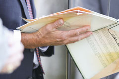 Businessman holding papers Stock Photo