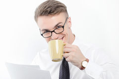 Businessman holding papers and cup of coffee Royalty Free Stock Photo